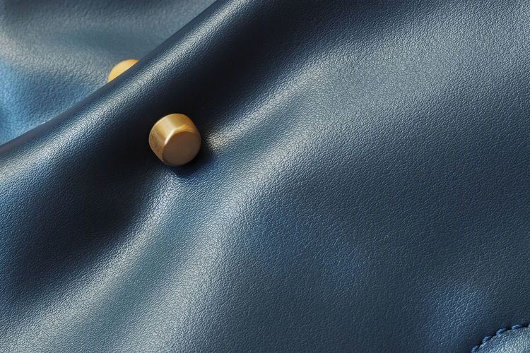 Detail of women's leather handbag of blue color, matte golden decor, copy space No People Textured  Leather Shape Copy Space Blue Pattern Backgrounds High Angle View Close-up Detail Leather Handbag  Accessories Accessory Decor Purse Bag Shopping Button Golden Genuine Material Surface