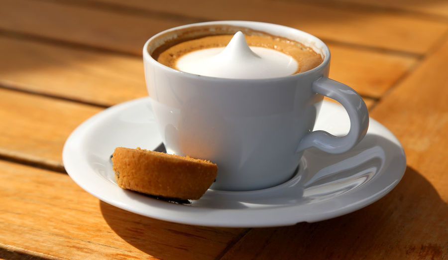 Caffeine Caffeine Addict Caffeine Addiction Cappuccino Close-up Coffee - Drink Coffee Cup Day Drink Food Food And Drink Freshness Froth Art Frothy Drink Indoors  No People Refreshment Saucer Sweet Food Table Wood - Material