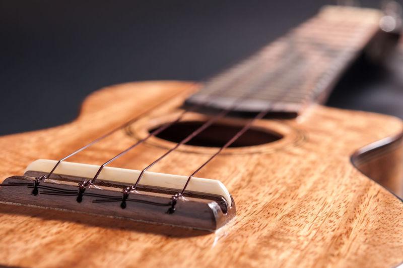Ukulele isolate black background Arts Culture And Entertainment Close-up Fretboard Guitar Music Musical Instrument Musical Instrument String Ukulele Ukulele Guitar Wood - Material