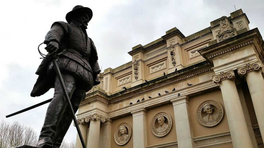 Sir Walter Raleigh Statue next to Pepys Building with Anson Cook  and Drake  Reliefs in Greenwich London Naval College Memorial