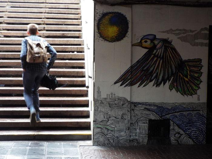 Street art captured in the metro station in Kiev, Ukraine. Kiev Kiev Ukraine Man On Stairs Metro Metro Station National Colors National Colours Stairs Street Art Street Art/Graffiti Subway Subway Station The Street Photographer - 2016 EyeEm Awards Ukraine