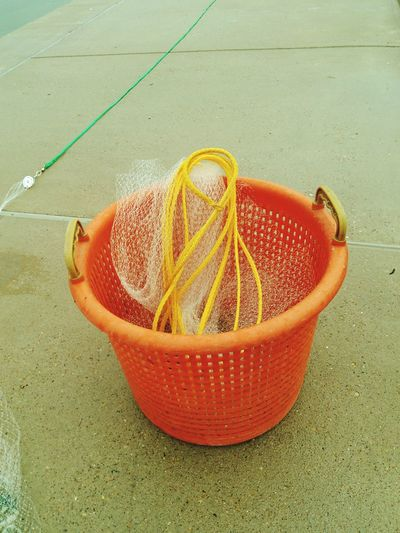My Cast Net and Bait Basket to catch bait fish ( Mullet )