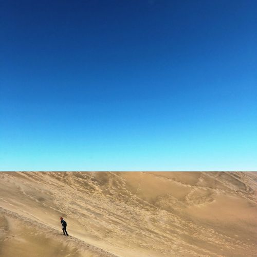 Life Valley Adventure Desert Sand Copy Space Arid Climate Clear Sky Blue Real People Nature Sand Dune One Person Landscape Outdoors Day Sunlight Lifestyles Leisure Activity Beauty In Nature Sky Scenics Love Yourself