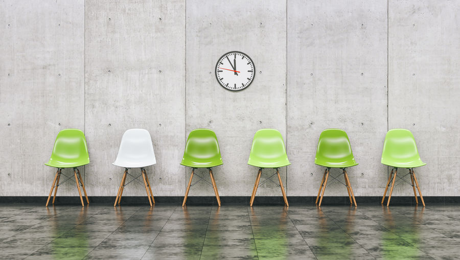 Chairs Against Gray Wall