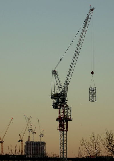 Crane - Construction Machinery Tower Cranes Building Exterior Day Outdoors Architecture No People Sky Sunset Silhouette