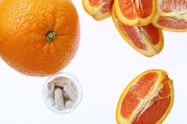 Directly above shot of orange fruit on white background