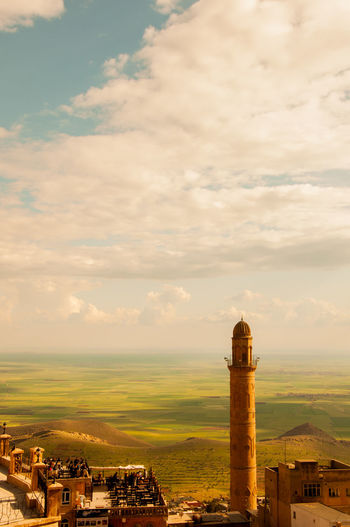 Mardin Architecture Mosque Old Turkey - Middle East Anatolia ASIA Building Exterior Built Structure Circa 14th Century Clear Sky Color Image Cultures Day Dome Eastern Anatolia Famous Place High Angle View High Up Horizontal Human Settlement Islam Landscaped Local Landmark Madressa Man Made Medieval Mesopotamian Middle East Middle Eastern Culture Minaret National Landmark No People Non-urban Scene Old-fashioned Outdoors Photography Place Of Worship Plain Public Building Religion Residential Building Sky Stone Material Sunny Travel Destinations Turkish Culture