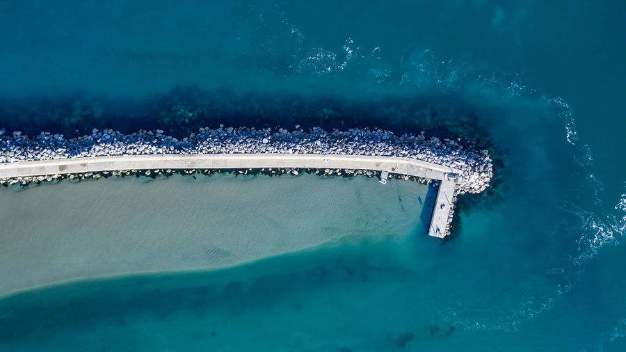 High angle view of groyne by sea