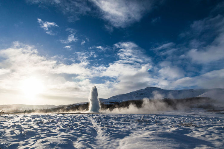 Low angle view of hot water spring against sky