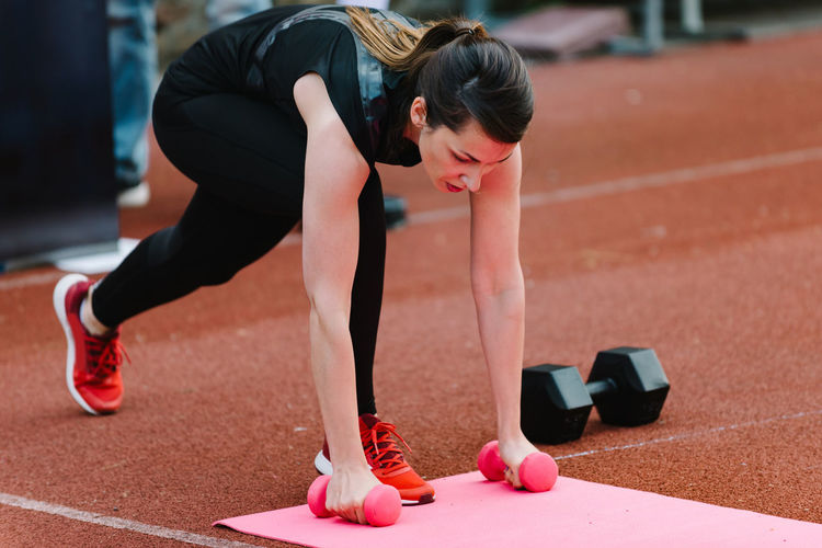 Young Woman On Competition Outdoors Exercise Competition Fitness Sport Young Female Healthy Body & Fitness Woman Training Athlete Lifestyle Athletic person Caucasian Strength Action Adult Activity Fit Active Motion Muscular Outdoors Workout