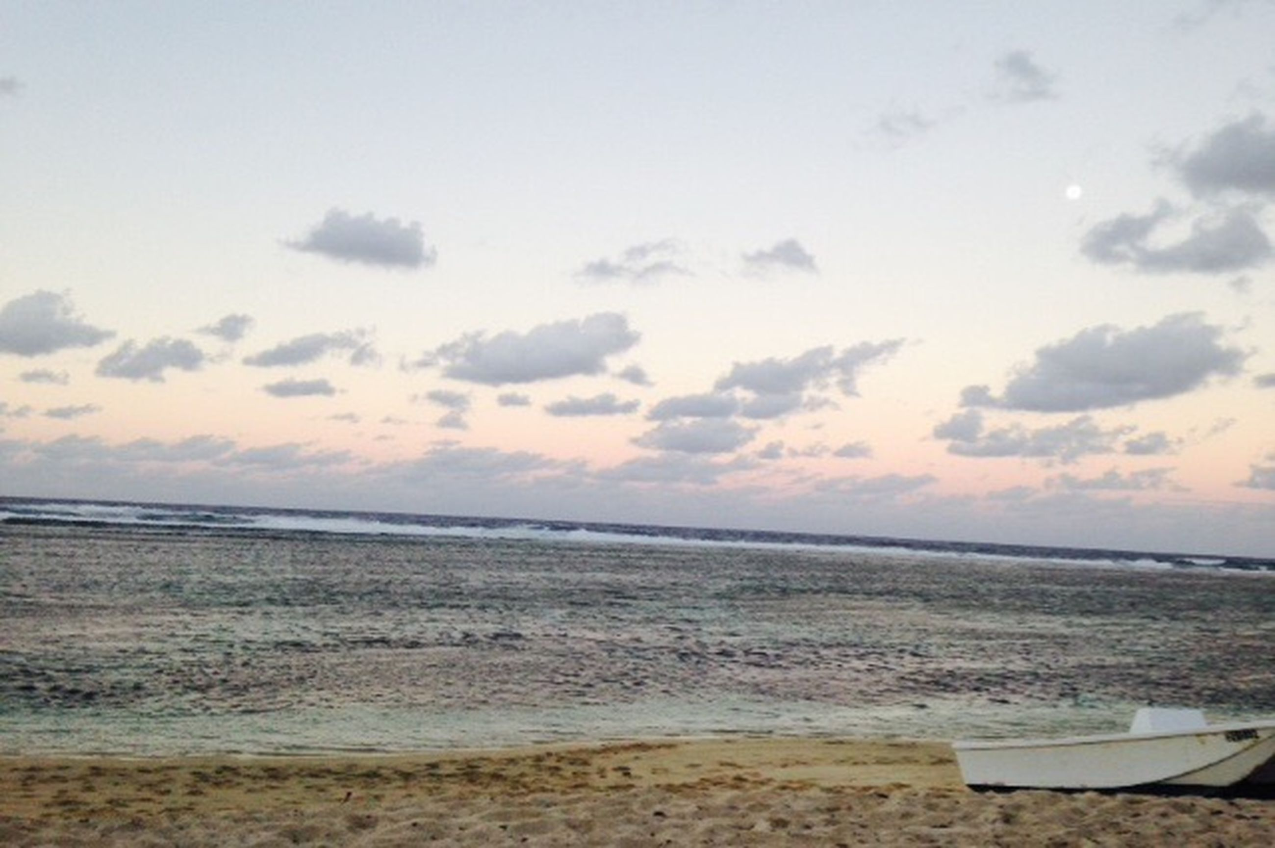 sea, beach, horizon over water, water, shore, sky, tranquil scene, tranquility, sand, scenics, beauty in nature, nature, cloud - sky, idyllic, coastline, cloud, calm, outdoors, remote, vacations