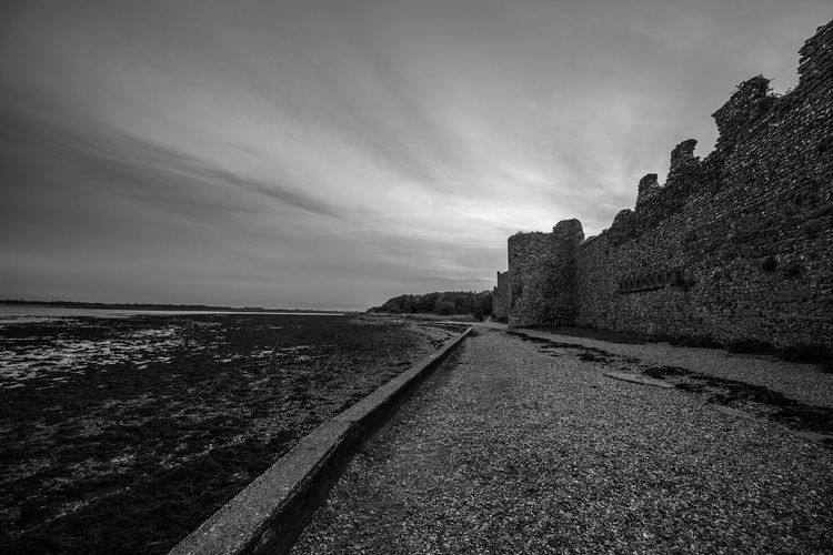 Portchester Castle By Sea Against Sky