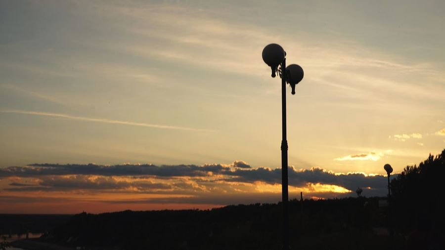 Low angle view of silhouette street light against sky during sunset
