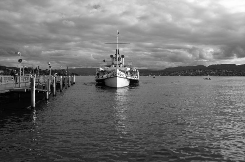 Black & White Harbor Beauty In Nature Black And White Cloud - Sky Darkness And Light Fujifilm_xseries High Contrast Lake Lake View Lake Zürich Mode Of Transport Monochrome Moored Nature Nautical Vessel Outdoors Paddlesteamer Red Filter Steamboat Transportation Travel Destinations Water Waterfront Incidental People