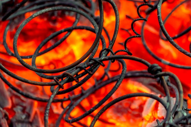 Close-up of coiled springs in bonfire