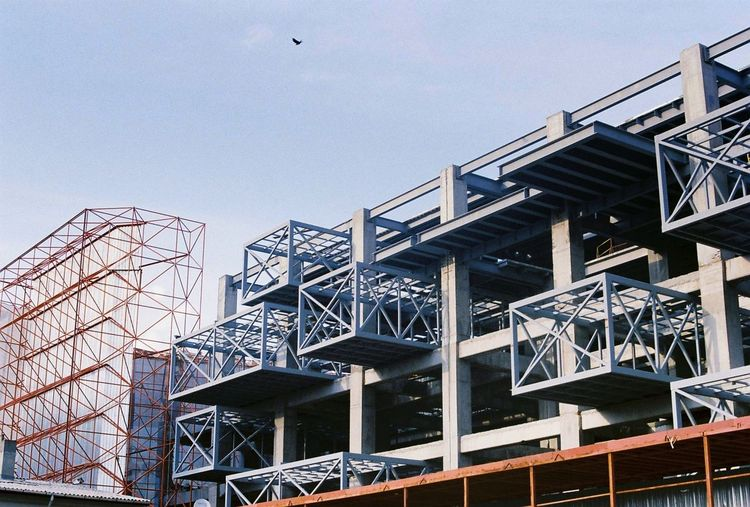 Low Angle View Of Under Construction Building Against Sky