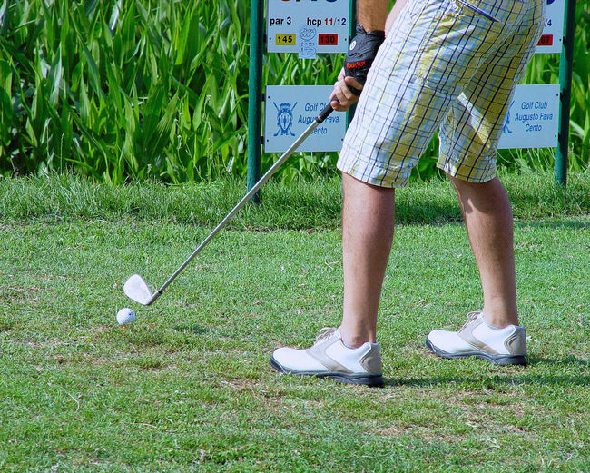 Close-up Day Daylight Golf Club Golf Shoe Golf ⛳ Golfer Grass Green - Golf Course Green Color Holding Legs Legs_only Leisure Activity Low Section One Person Only Legs Outdoors Part Of The Body People Sport Sport Photography Standing Sunnyday 🌸🌷🌿