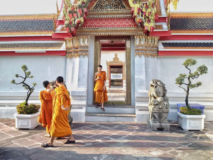 Monks walking outside temple