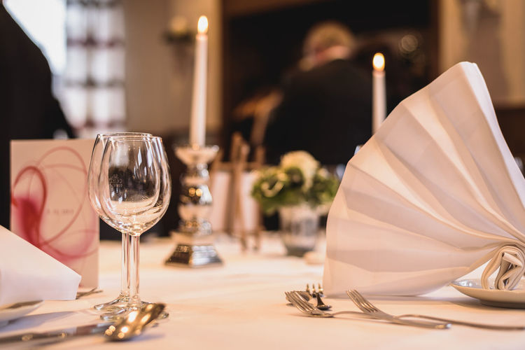 Close up of festive table decoration in a restaurant during a wedding party Solemn Wedding Alcohol Bride Celebration Close-up Day Drink Drinking Glass Festive Food And Drink Indoors  Plate Restaurant Romance Table Togetherness Wine Wineglass
