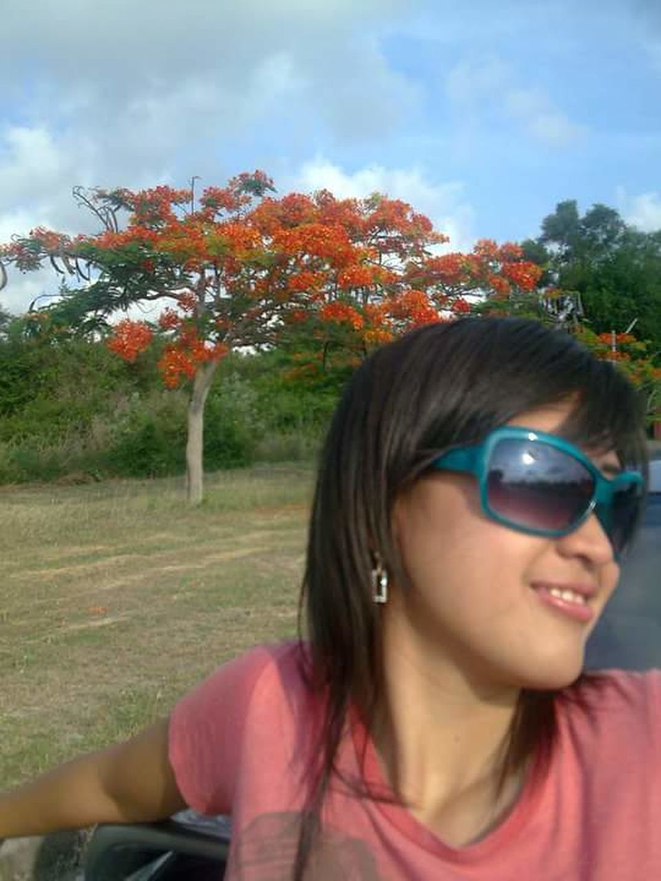 sunglasses, tree, one person, outdoors, day, leisure activity, young adult, nature, young women, sky, real people, grass, adult, people