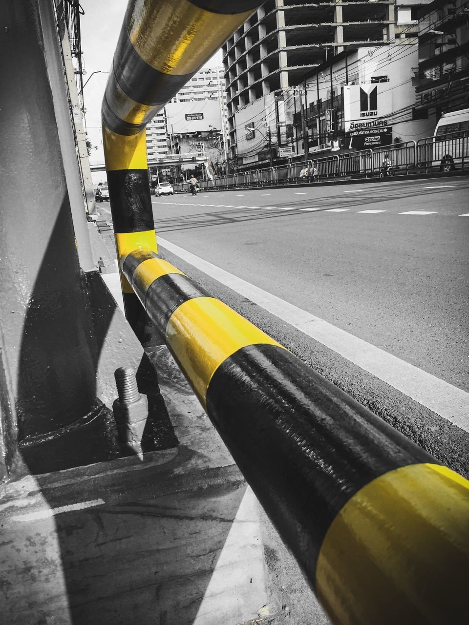 architecture, city, built structure, building exterior, transportation, street, yellow, road, sign, day, road marking, symbol, outdoors, nature, marking, mode of transportation, close-up, no people, city life, security, dividing line