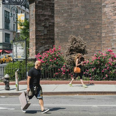 Woman in Sportswear at the SidewalkAcross on 20thstreet NYC streetphotography 50mm urban people instapeople Manhattan