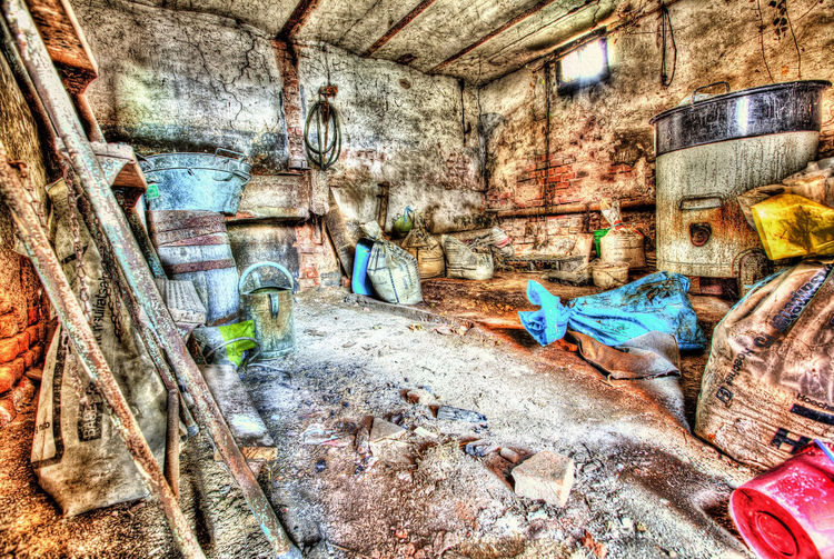 stock full of clutter at an abandoned barn, HDR-photo Barn Damage Decay Junk Messy Rubbish Rust Abadoned Disorganised Eroded Group Masonry Ruin Sandstone Stock Stone Stone Wall Structure Urban Bowl Ladder