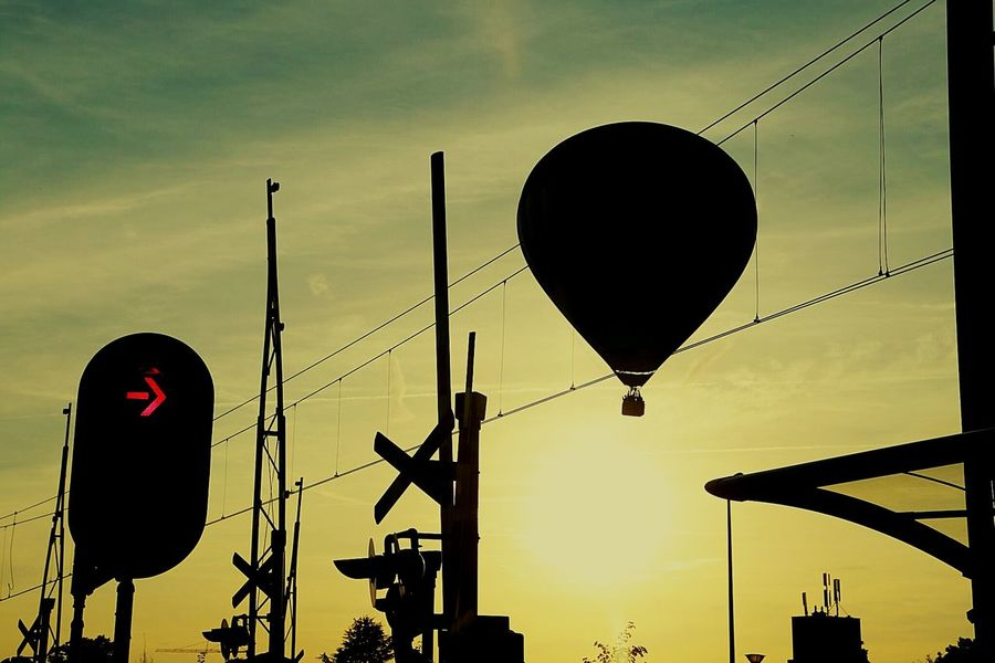 AirBalloon Hot Air Balloon Balloon Silhouettes Streetphotography Throughmywindshield From A Moving Vehicle Sun Railroadcrossing Sky_collection