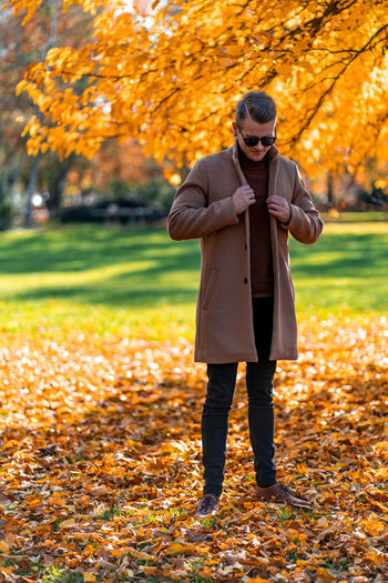 Full length of man standing in park during autumn