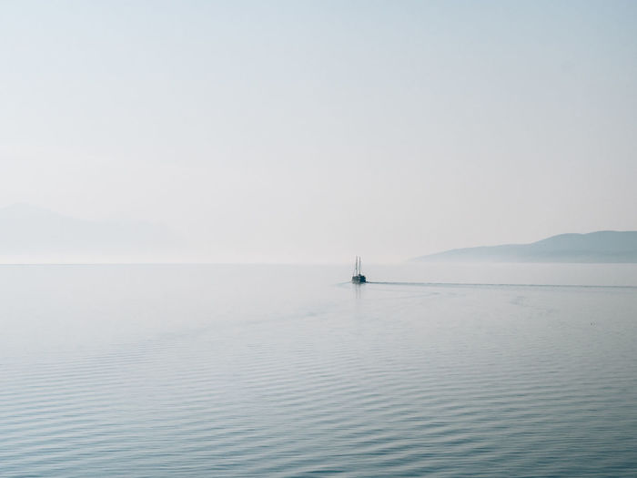 Into the Mist Beauty In Nature Blue Calm Clear Sky Eyeemphoto Day Distant Mountain Nature Non-urban Scene Ocean Outdoors Remote Scenics Sea Seascape Solitude Tranquil Scene Tranquility Water Waterfront The Great Outdoors - 2017 EyeEm Awards