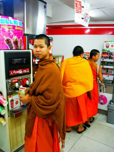 Buddhist Monk Buddhist Monks Ancient And Modern Old And New Conceptual Contrast Ironic  Funny Chiang Mai Thailand Chiang Mai | Thailand Chiang Mai Religious  Monks Monk  Seveneleven Seven Eleven Slurpee Slurpee Time Kid Monk Young Monk Clash Culture Clash Culture Contrast