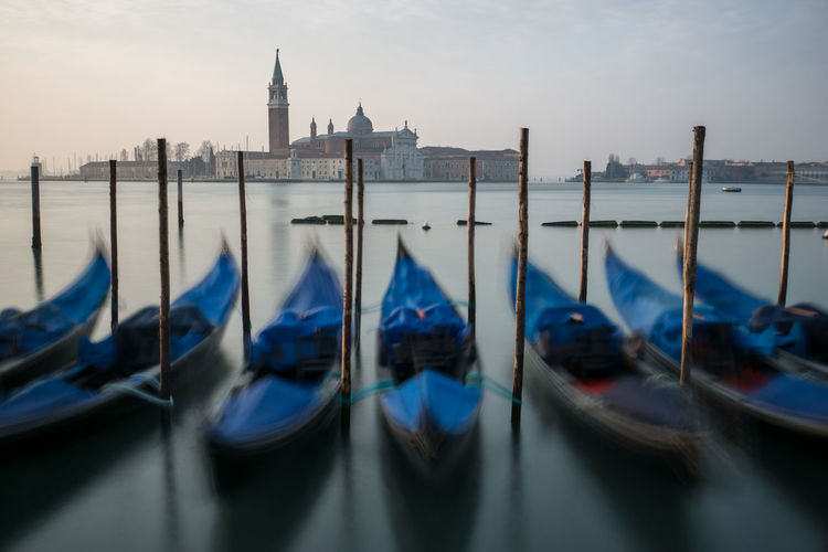 Gondolas Moored On Lake With Church Of San Giorgio Maggiore On Background