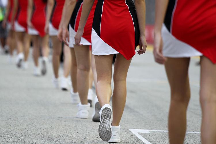 Low section of women walking on street