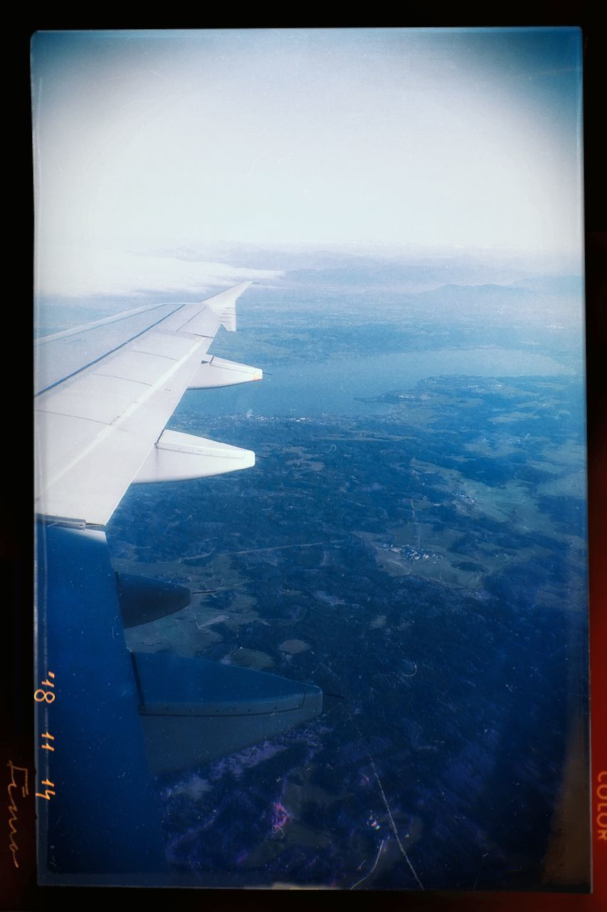 airplane, air vehicle, transportation, mode of transportation, flying, aircraft wing, travel, window, aerial view, nature, sky, journey, transfer print, day, no people, landscape, auto post production filter, water, outdoors, transparent
