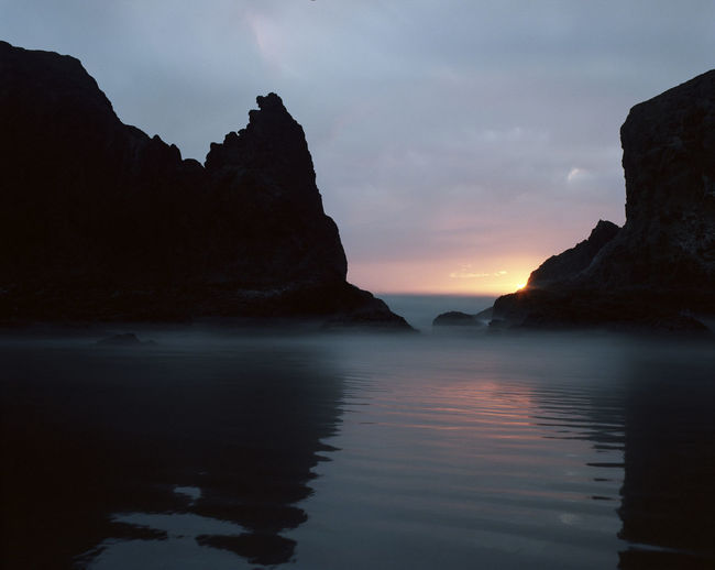 Bandon Beach Beauty In Nature Colorful Day Film Photography Nature No People Ocean Oregon Coast Oregon Sunset Outdoors Reflection Rock - Object Rock Formation Scenics Sea Sky Southern Oregon Sunset Tranquil Scene Tranquility Twlight Water Waterfront The Great Outdoors - 2017 EyeEm Awards