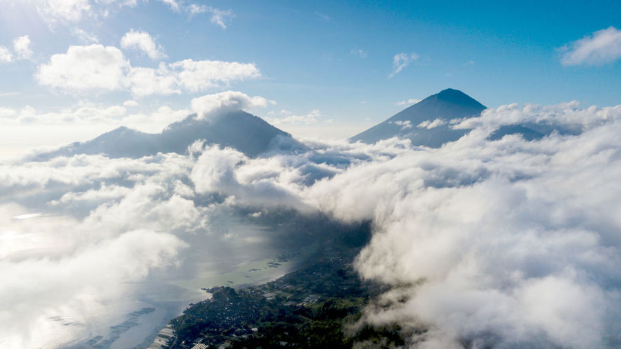 Drone view flying high above the clouds Above The Clouds Beauty In Nature Cloud - Sky Cloudscape Day Environment Fluffy Flying Idyllic Landscape Mountain Mountain Peak Mountain Range Nature No People Non-urban Scene Outdoors Plant Scenics - Nature Sky Softness Tranquil Scene Tranquility White Color