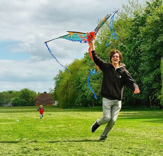 Kite Flying Kite Dragon Man Dad Fun Play Toddler  Green Green Grass Check This Out Running Chasing Catching Capture The Moment Capture Snap Snapshots Of Life The Portraitist - 2016 EyeEm Awards Second Acts