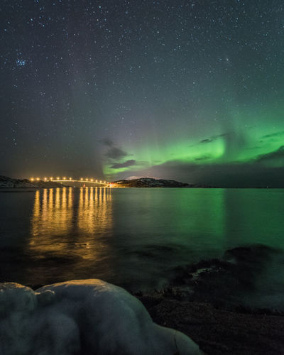 The bridge to Sommaroy and the northern lightss reflecting on the sea water Moody Sky Northern Lights Norway Arctic Astronomy Beauty In Nature Bridge Bridge - Man Made Structure Fjord Frozen Nature Galaxy Long Exposure Nature Night No People Outdoors Reflections Reflections In The Water Scenics Sea Sky Star - Space Tranquil Scene Tranquility Water