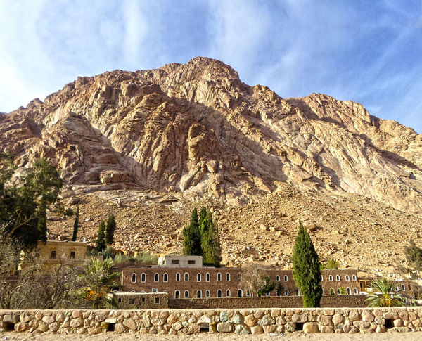 Saint Catherine's Cathedral Ancient Civilization Architecture Blue Sky Building Exterior Chatedral Church Day Hiking History Landmark Landscape Low Angle View Mountain Mountain Valley Mountain View Mountains And Sky Nature Nature No People Old Buildings Outdoors Sky Sky And Clouds Sunlight