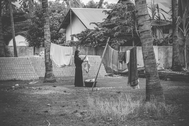 Clothes drying outside house against sky