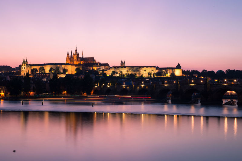 Prague old town seen from the vltava river at sunset