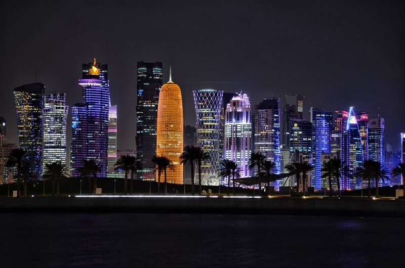 Qatar doha cornice cityscape at night. City Cityscape Urban Skyline Illuminated Modern Skyscraper Nightlife Multi Colored City Life Party - Social Event Electric Light Filament Pendant Light Light Fixture Recessed Light Light Bulb Christmas Market Financial District  Firework - Man Made Object Tree Topper Entertainment Ferris Wheel Glowing
