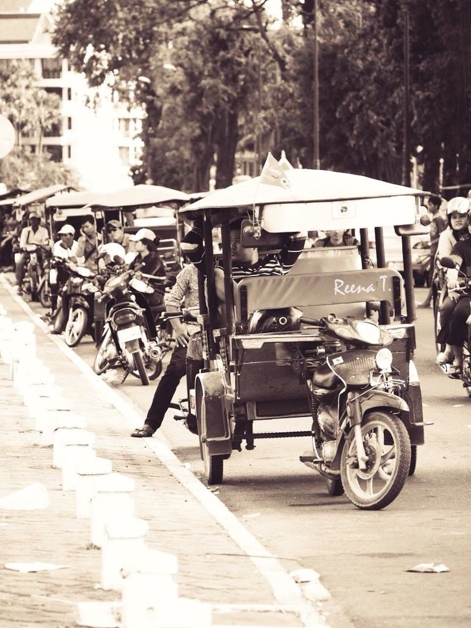transportation, mode of transport, land vehicle, outdoors, day, tree, real people, men, road, architecture, one person