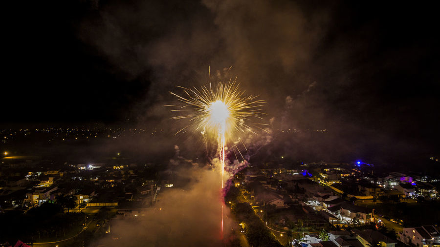 Architecture Arts Culture And Entertainment Building Exterior Celebration Celebration Event City Cityscape Event Exploding Firework Firework - Man Made Object Firework Display Illuminated Long Exposure Low Angle View Motion Multi Colored Night No People Outdoors Sky