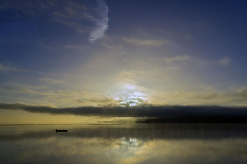 A fisherman deploys a net on Lake Cuitzeo during the sunrise. Cloud - Sky Sky Scenics - Nature Water Beauty In Nature Tranquility Tranquil Scene Sunset Reflection Nature Waterfront Idyllic No People Lake Non-urban Scene Outdoors Sunlight Nautical Vessel