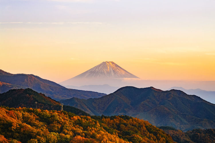 Scenic autumn view of mt. fuji against sky during sunset