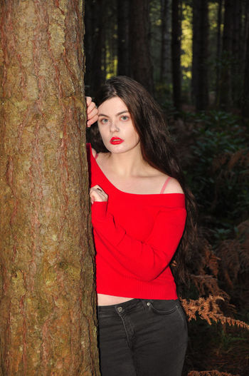 Beautiful young lady in a red jumper in a forest in the autumn Girl Millenial Young Lady Red Red Color Red Lipstick Forest Trees Beauty Beautiful Woman Beautiful Long Hair Portrait Portrait Of A Woman Portrait Photography Tree Trunk Red Jumper Stunner Beautiful Young Lady Beautiful Young Woman Autumn Autumn colors autumn mood Tree One Person Young Adult Trunk Women Three Quarter Length Standing Looking At Camera Young Women WoodLand Outdoors