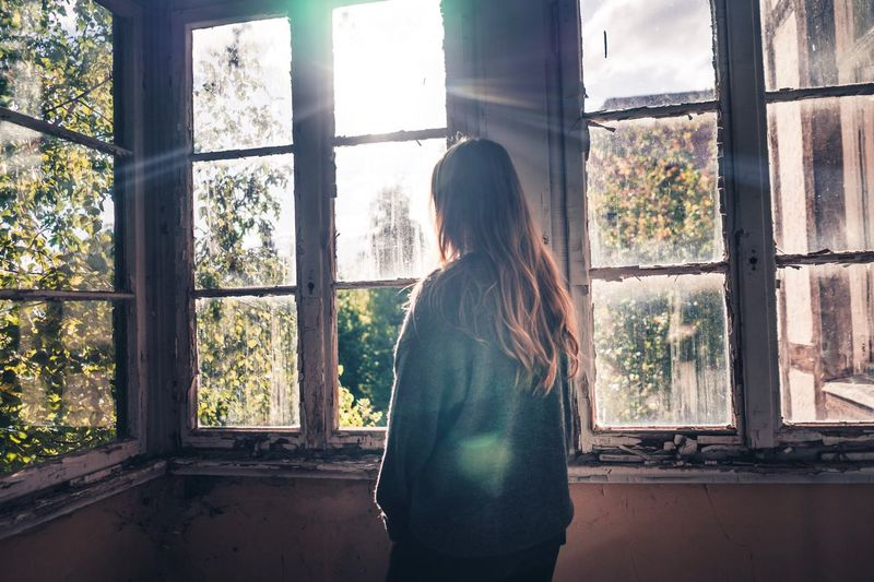 Look through the window into the sun and enjoy your life. Window Indoors  Standing Looking Through Window Women Architecture Lostplaces Dilapidated Old House Ghostly Sun Sun Flare Sunbeam Autumn Leaves Girl Brown Hair Light Wood