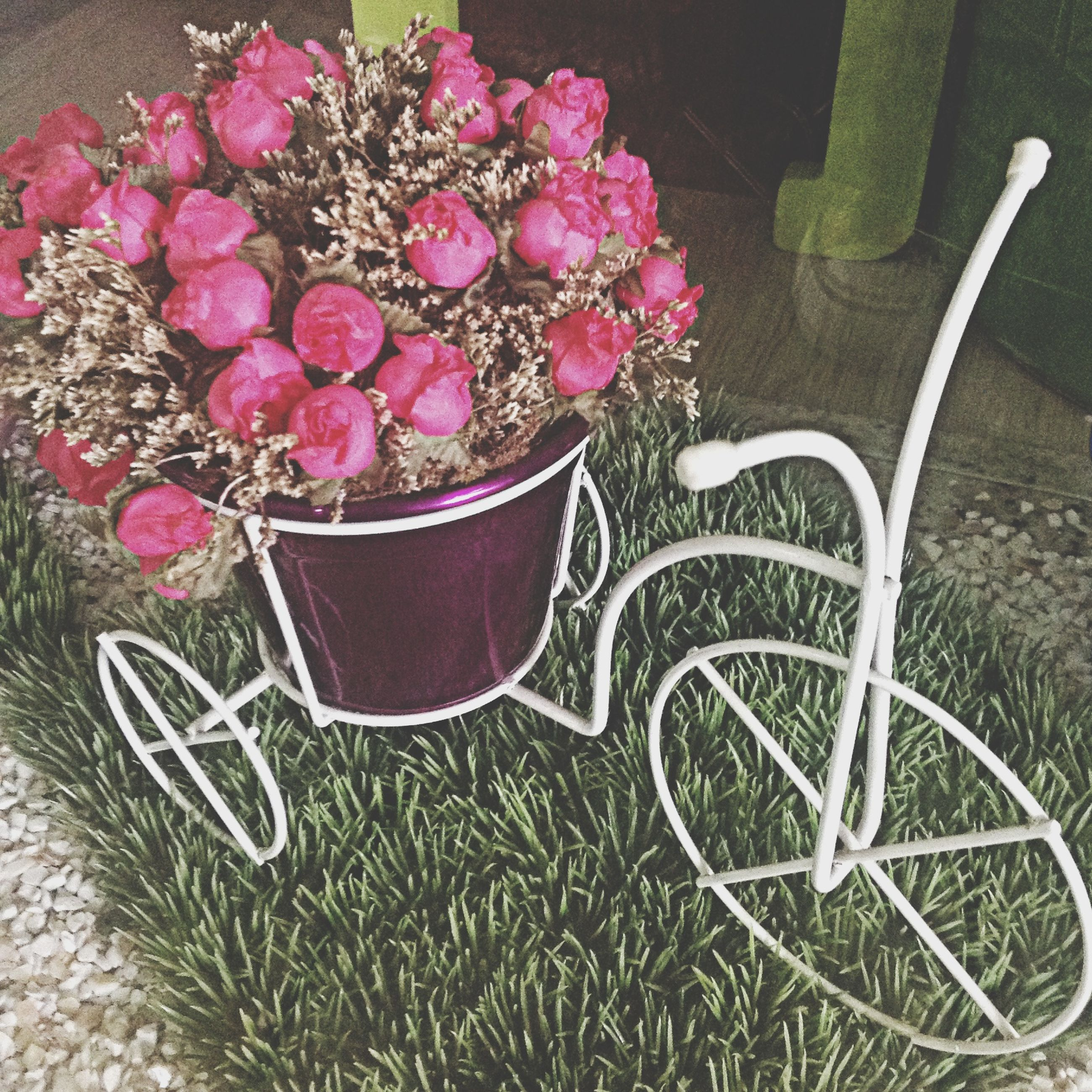 flower, high angle view, plant, freshness, growth, pink color, nature, table, no people, beauty in nature, potted plant, day, sunlight, outdoors, fragility, park - man made space, basket, close-up, petal, decoration