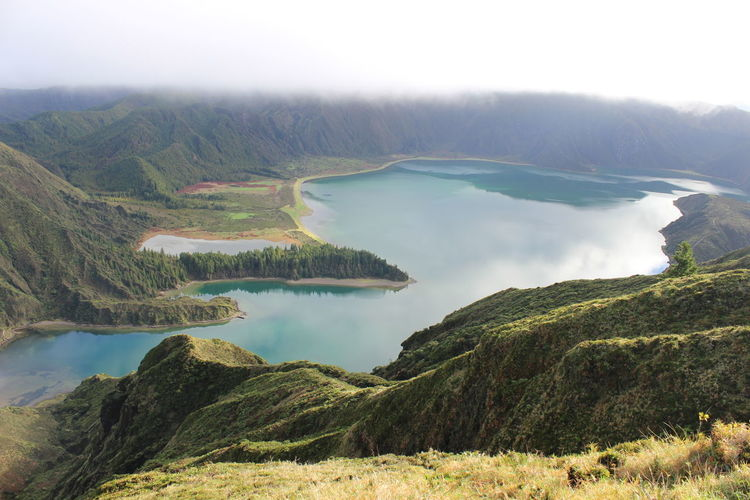 Scenic view of lake amidst mountains at sao miguel